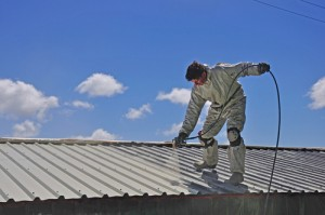 Man spraying roof